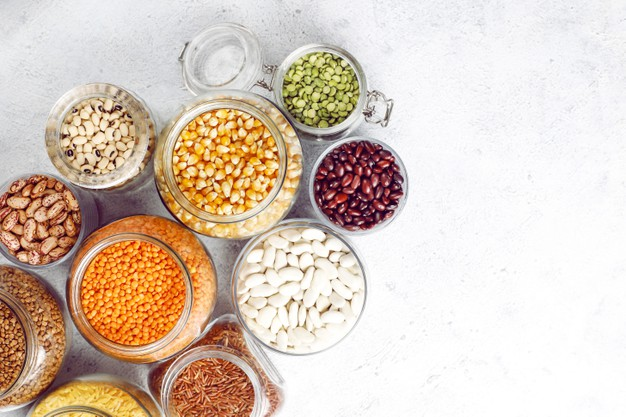 legumes-beans-assortment-different-bowls-light-stone-top-view-healthy-vegan-protein-food_114579-13629